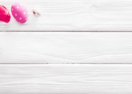 Easter Eggs with Flowers on White Wooden Background